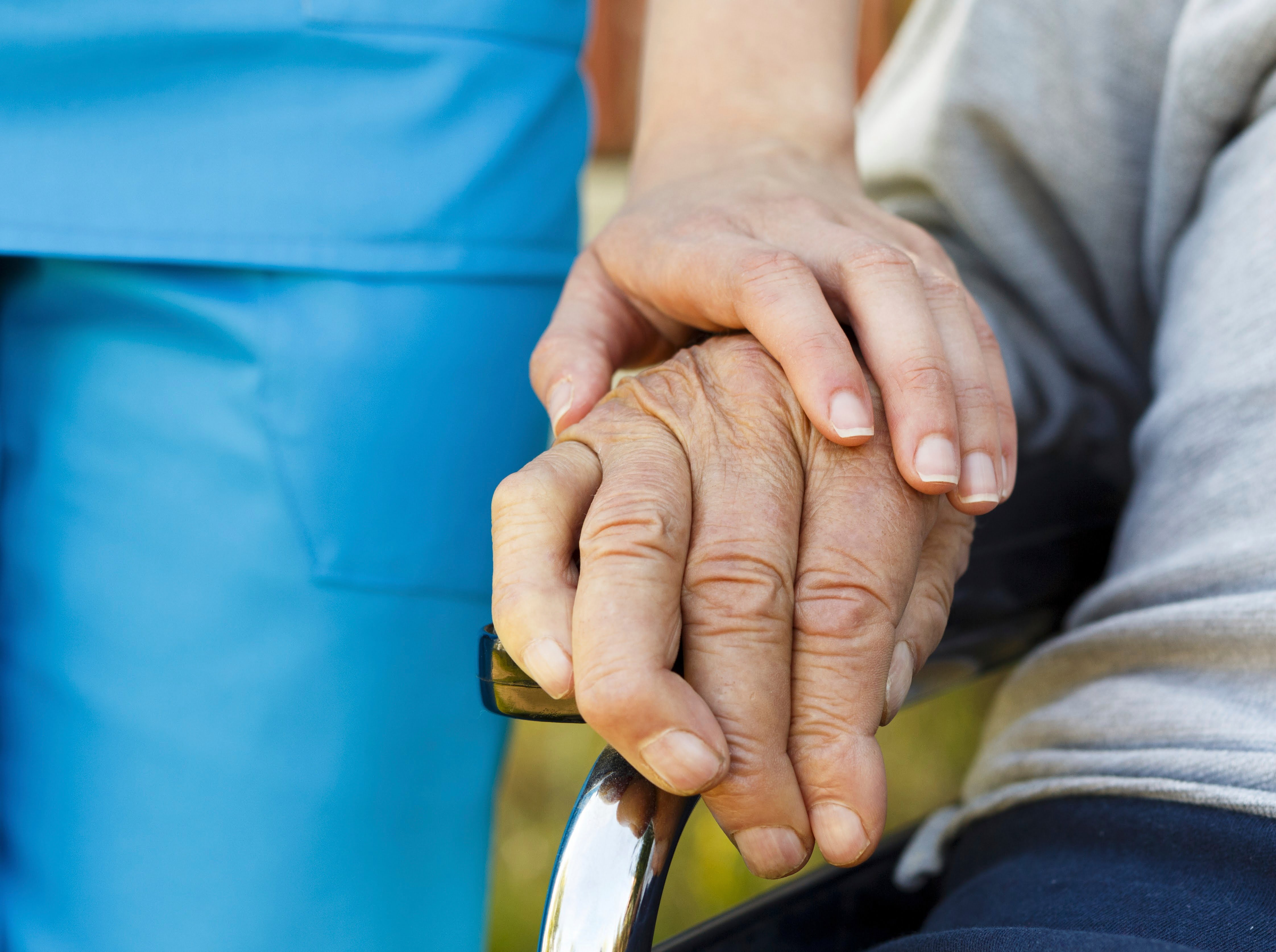 Conceptual image - support for the elderly in wheelchair.